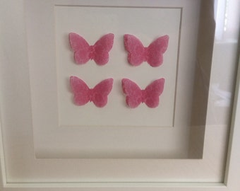 Beautiful butterflies cut from paper and vellum in a shadow box frame.