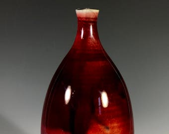 Deep red porcelain bottle