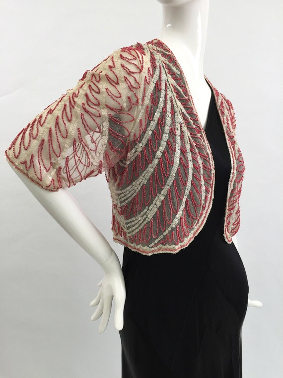 1920s beaded sequinned jacket in white and red bea