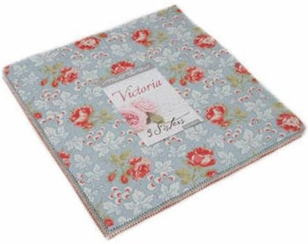 Victoria Layer Cake by 3 Sisters for Moda Fabrics.  beautiful floral dots and leave reds, pinks, blues and cream. elegant. 44260LC