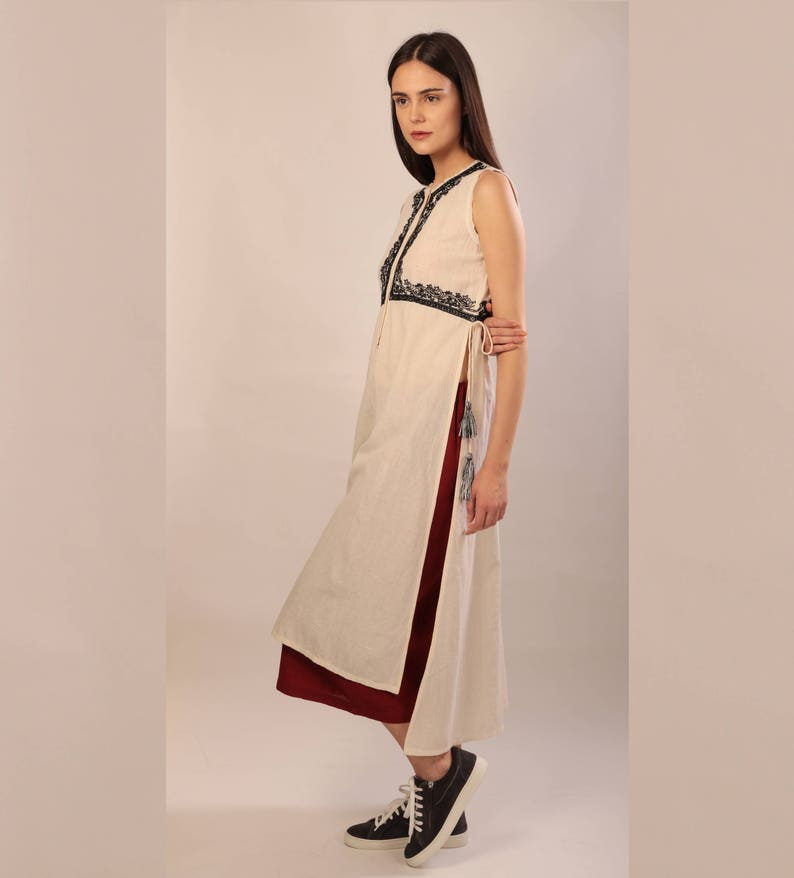 4648c24a60b0e8 Ivory khadi top with high slits cotton sleeveless top with