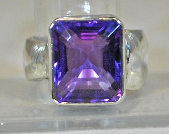 Sterling silver ring with amethyst setting.