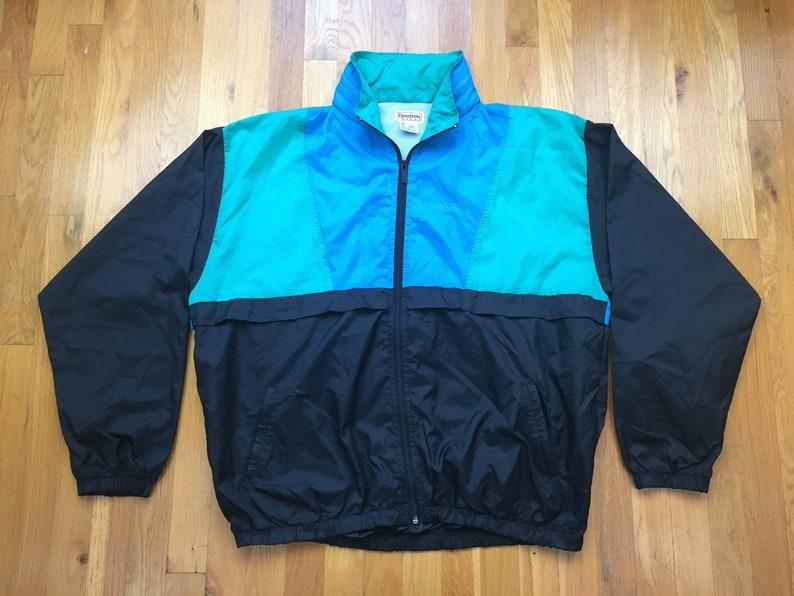 77633437fffde Vintage 90s Reebok jacket size L windbreaker full zip spellout spell out  90s hip hop rap color blocking blue black usa reebok sport jacket