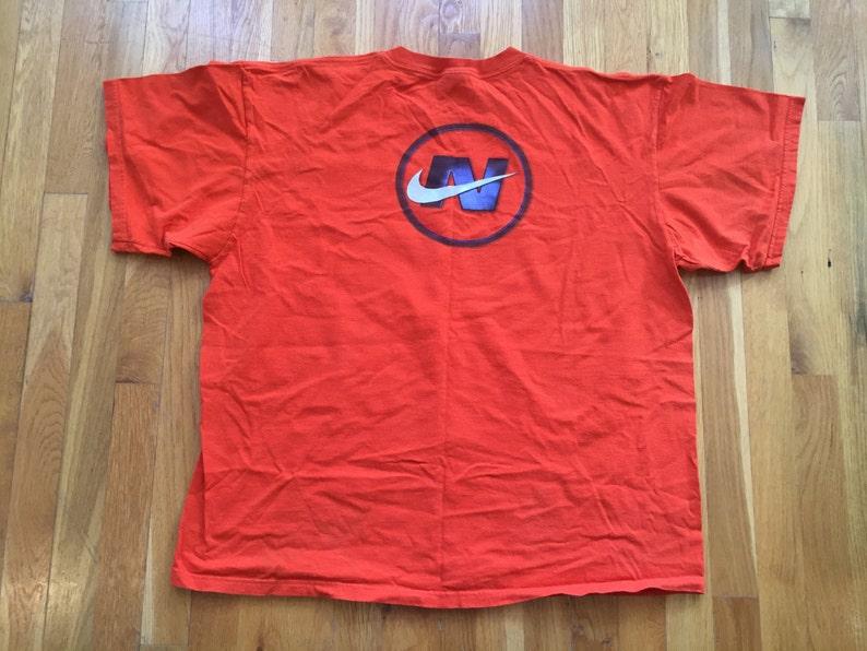 7888515922bd Vintage Nike t shirt 90s Nike shirt orange nike swoosh nike