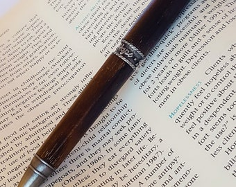 "Handcrafted ""Faith, Hope and Love"" twist style pen in Ziricote with antique pewter accents"
