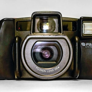 OLYMPUS IS-20200 QuartzDate  All-in-One Camera with 28mm 110mm Aspherical Lens.