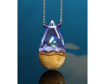 Purple crystal teardrop pendant, resin and wood necklace. Handmade hybrid jewelry.
