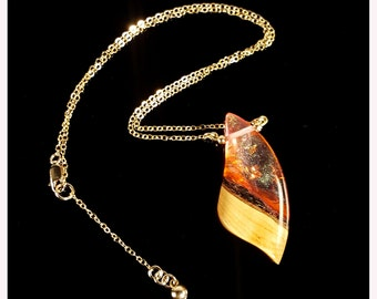Fire Fang Pendant, iridescent red resin and wood necklace.