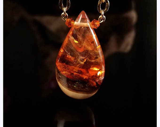 Orange Magma Crush Teardrop Pendant, resin and wood necklace.