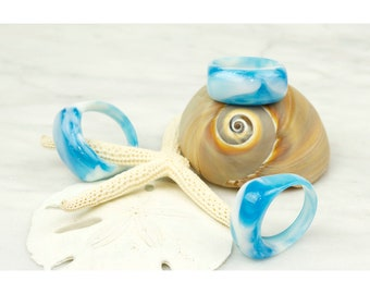 Blue Cloud Rings, iridescent swirling clouds of white and blue resin, hand carved and polished.