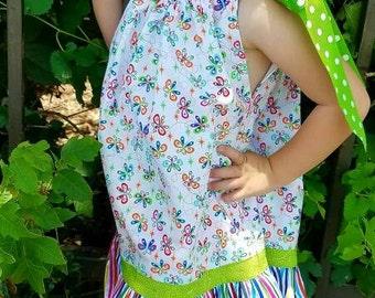 Adorable girls sundress.  Ruffled pillowcase style sundress/top.  Butterfly print designer cotton fabric. Orange, aqua, blue, lime green