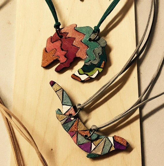 Conservation Critter Necklaces - Geometric Pangolin and Otter Statement Necklaces
