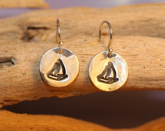 Sterling and Fine Silver Antiqued Sailboat Disk Earrings.