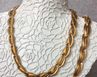 Three Piece Trifari  gold toned set.
