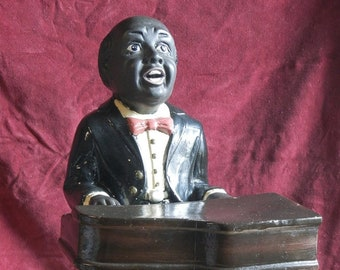 Moulded Ceramic Figurine of a Jazz Pianist.