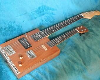 6 String electric, 4 string Cavaquinho Cigar-box guitar.