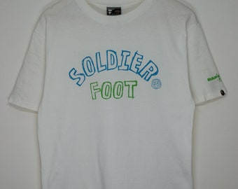 70715d06 Vintage Early 2000s A Bathing Ape Foot Soldier SpellOut White Medium T-shirt