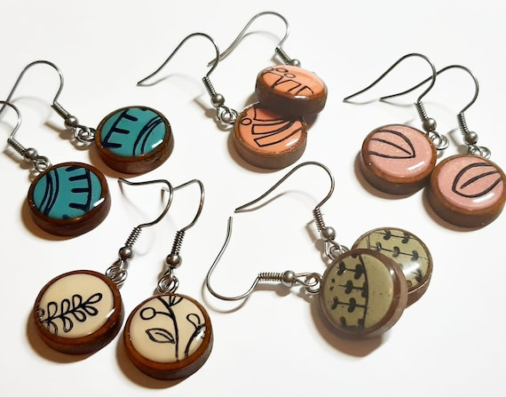 Wooden earrings, colour and black pattern