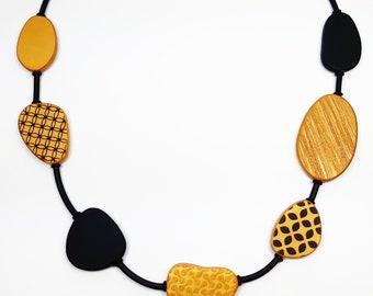 Saffron and black necklace