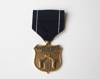Vintage US Coast Guard expert pistol shot medal.  Marksmanship Medal United States Navy and the U.S. Coast Guard military with ribbon. USCG.