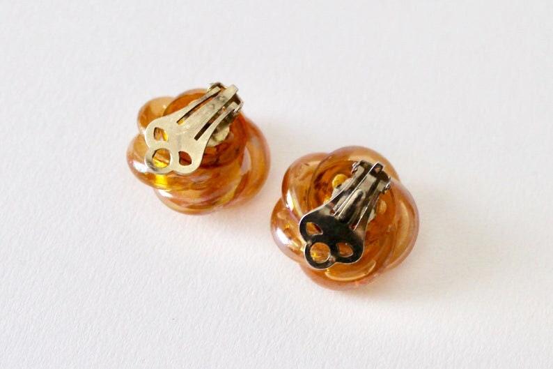 1950/'s twist knot statement orange rainbow coated tubular knot clip on earrings. Vintage orange rainbow lustre knot clip on earrings
