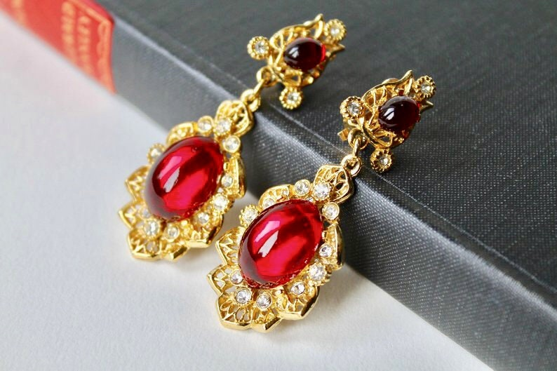 Rhinestones Indian inspired earrings Faux ruby cabochon chandelier earrings. Vintage Sphinx gold and red cabochon dangle clip on earrings