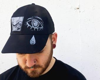 a10aa2140a4 White hat black eyes