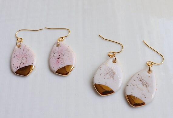 Teardrop shaped white / baby pink gold splashed porcelain dangle earrings