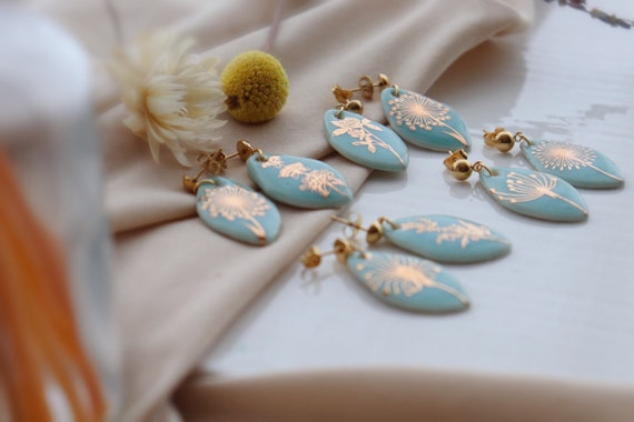 Asymmetrical light blue olden plants porcelain dangle earrings