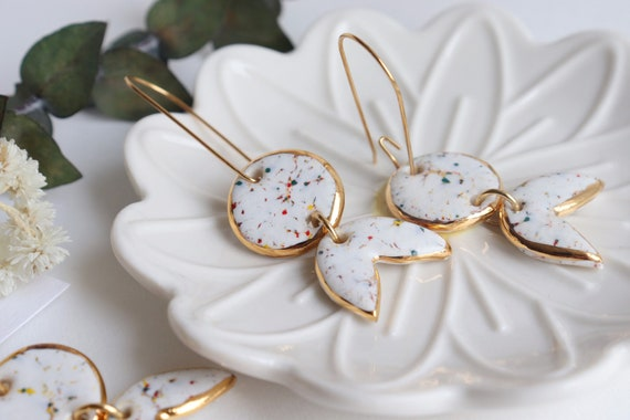White colorful speckles  gold contoured chandelier porcelain dangle earrings