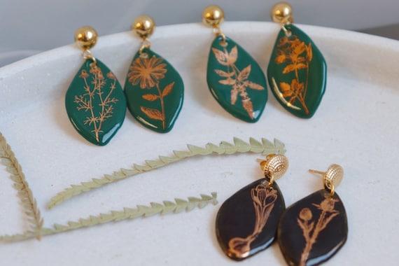 Green / black golden plants porcelain dangle earrings