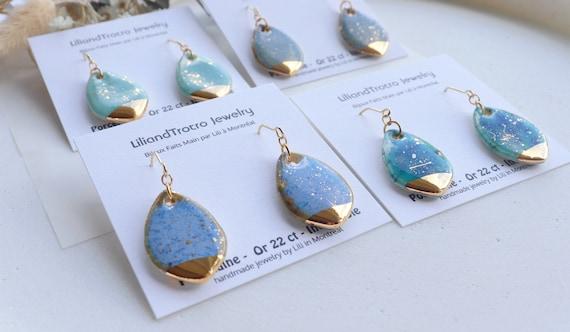Teardrop shaped gold splashed porcelain dangle earrings