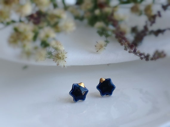 Dainty Flower navy blue ceramic studs /22kt gold luster