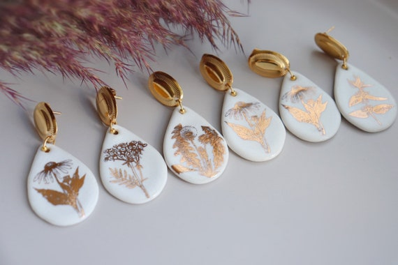 Teardrop shaped white & golden plants porcelain dangle earrings