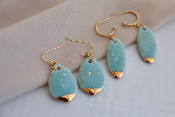 Light turquoise   Gold splashed porcelain dangle earrings