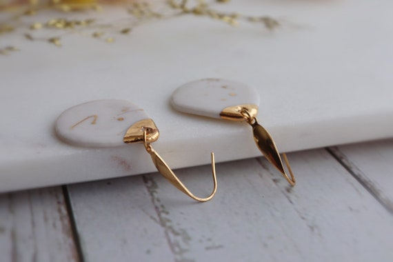 Tear drop white porcelain gold splattered earrings