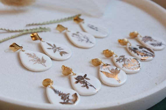 Teardrop shaped white & golden plants porcelain dangle earrings