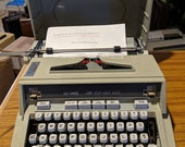 1971 Seafoam Green Hermes 3000 portable typewriter with Script (cursive) font and case