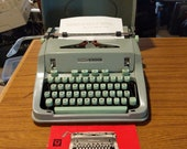 1967 Seafoam Green Hermes 3000 portable typewriter with case lid and instruction manual