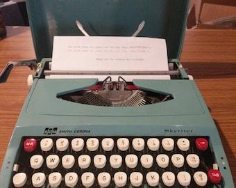1970's turquoise Smith Corona Skyriter ultra portable typewriter