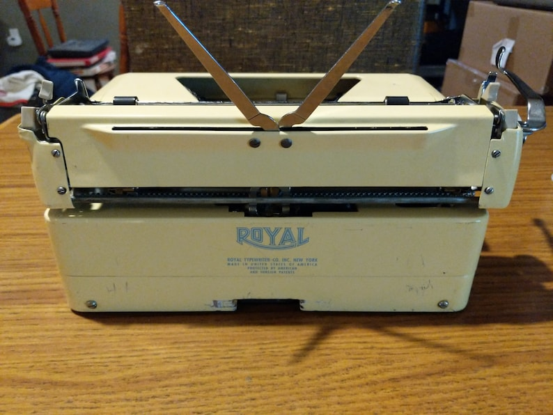 1955 Banana Yellow  Royal Quiet Deluxe portable typewriter with case.