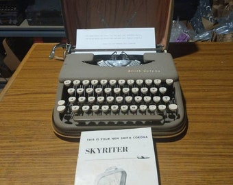 1958 Smith Corona Skyriter ultra portable manual typewriter with carrying case and owner's manual