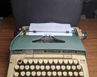 1970's green Smith Corona Galaxie Deluxe manual portable typewriter with original paperwork