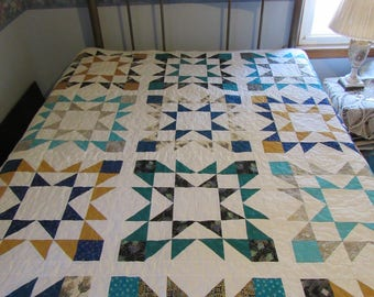 Homemade handmade twin bed blue gold and teal star quilt