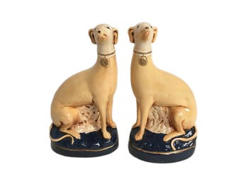 Pair of Glazed Ceramic Dogs