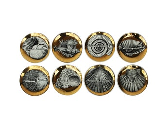 "Complete set of Eight ""Conchyliorum"" Gilt Porcelain Coasters by Piero Fornasetti"