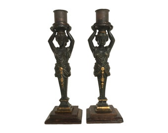 Pair of Patinated Figural Bronze Candlesticks