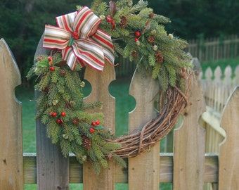 Christmas wreath with pine foliage and berries, bright bow!