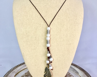 Freshwater Pearls on Leather with Feather