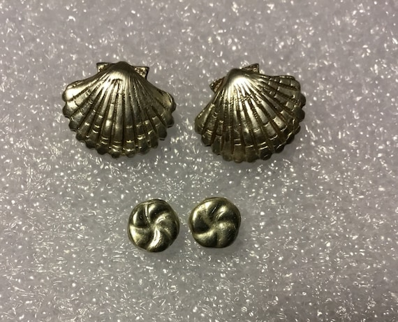 Sea shell stud earrings.Fine silver shell and twisted knot stud earrings .